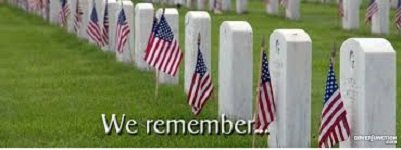 Image of military grave yard with American flags posted and words We Remember