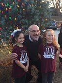 Mayor Skip Wilson with two Jingle Jam singers